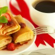 Stock Photo: Fritters with red ribbon and mint and cup of coffee
