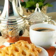 Stock Photo: Cookies and coffee on table with natural flowers, table silver