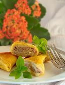 Fritters with meat and a basil, natural flowers — Stock Photo