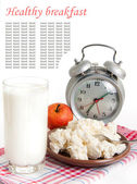 Milk, cottage cheese and alarm clock on the red napkin — Stock Photo