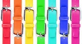 Leather belts of all colors of a rainbow — Stock Photo