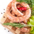 Stock Photo: Sausage from pork and beef, tomatoes, salad and spices