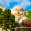 The Catholic temple in Israel, pink domes against a blue sky — Stock Photo