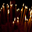 Stockfoto: Burning candles in temple, sacred fire