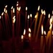 Burning candles in the temple, sacred fire - Stock Photo