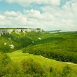 Mountains, sky and green fields in the Crimea, Ukraine - Stock Photo
