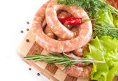 Sausage from pork and beef, tomatoes, salad and spices — Stock Photo