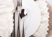 Table fork and knife in a napkin of medieval style — Stock Photo