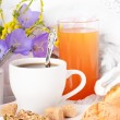 Breakfast from coffee with rolls, juice on delicate serviettes — Stock Photo #11572707