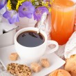 Breakfast from coffee with rolls, juice on delicate serviettes — Stock Photo
