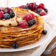 Stock Photo: Pancakes with berries on white background