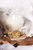 Jug with milk, bread on a white background — Stockfoto