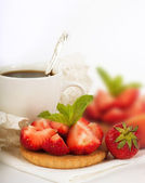 Strawberry with a mint and cup of coffee on a white background — Stock Photo
