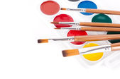 Pencils, paints and brushes on a white background — 图库照片