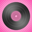 Black vinyl record on pink dotted background — Stock Photo