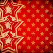 Red grunge background with stars — Stockfoto