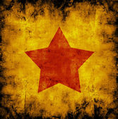 Red star on an orange background — Stock Photo