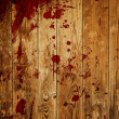 Red paint splash on wood plank — ストック写真