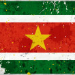Grunge Surinam flag with stains — Foto Stock