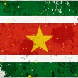 Grunge Surinam flag with stains — Stock Photo