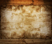 Old paper on brown wood texture — Stock Photo