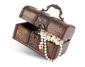 Age-old trunk with valuables — Stock Photo