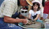 Child makes the molding clay — Stock Photo