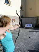 A girl taking aim in the archery range symbolize objective — Stock Photo