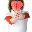 Teenage girl holding red origami heart — Stock Photo
