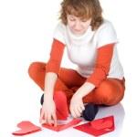 Girl making origami heart — Stock Photo #11387217