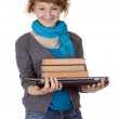 Student with books on laptop — Stock Photo