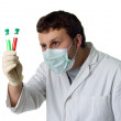 Stock Photo: Scientist looking a test-tube