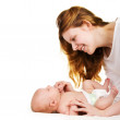 Happy smiling mother playing with her baby — Stock Photo