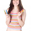 Young smiling girl holding colour pencils — Stock Photo