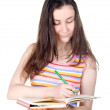 Smiling girl with notebook and pencil — Stok Fotoğraf #11387355