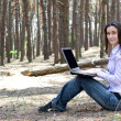 Young businesswoman with laptop working outdoors — Stock Photo