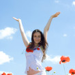 Girl in poppy field — Stock Photo #11387439