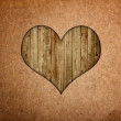 Old paper with wooden heart — Stock Photo