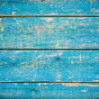 Blue paint on old wooden fence — Stock Photo