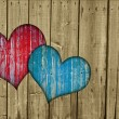 Wooden fence with two hearts - Stock Photo