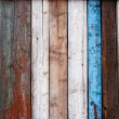 Old multicolored wooden fence - Foto Stock