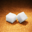 Lump sugar on sacking - Foto Stock