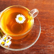 Cup of aromatic camomile tea — Stock Photo