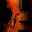 Vintage violin detail isolated on black — Stock Photo