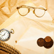 Antique money with watch, glasses and rope on envelope — Stock Photo