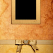 Vertical grunge fabric photo frame with bow — Stock Photo