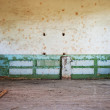 Abandoned room with wooden floor and painted wall — Stock Photo