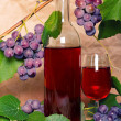 Wine with red bunch of grape — Stock Photo