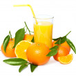 Fresh orange juice with many ripe mandarins — Stock Photo