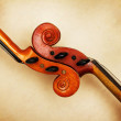 Two old violin scrolls detail in ambient light — Stock Photo #11388486